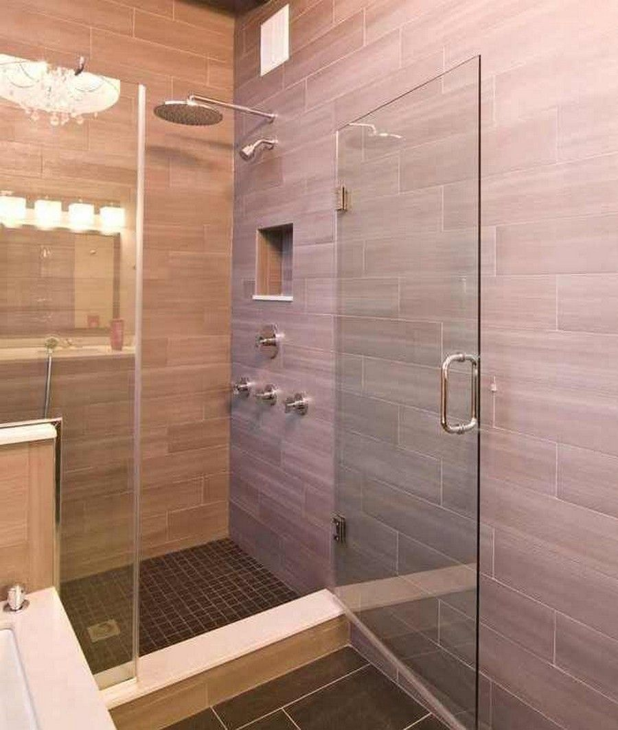modern bathroom with hanging rainfall shower heads and glass shower stalls also natural tile siding wall design ideas impressive loft condo renovation by