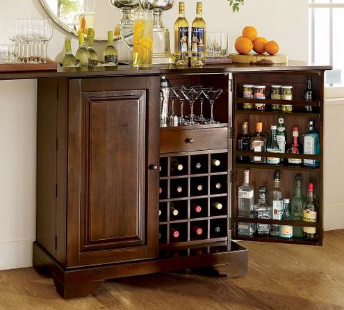 pottery barn continues their tradition of fine furniture with their new modine bar that makes use of every bit of interior storage space