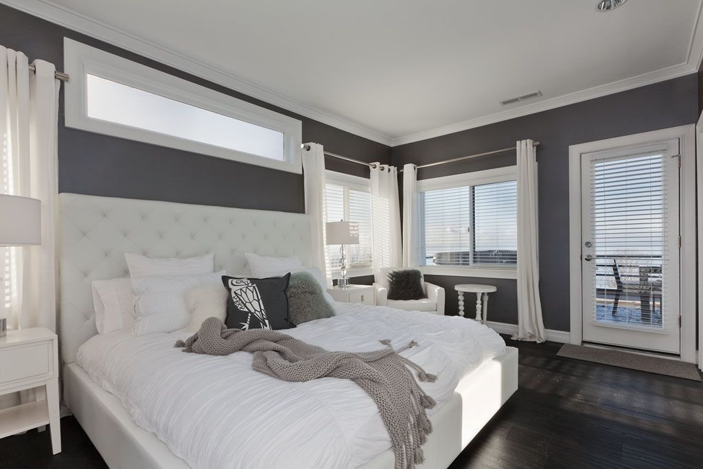 contemporary guest bedroom with pottery barn lorraine tufted tall headboard bed hardwood floors - Louvered Bedroom Decor
