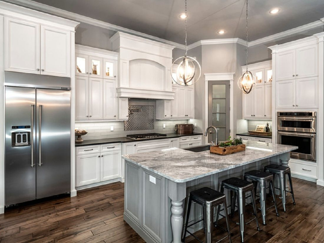 Classic L Shaped Kitchen Remodel With White Cabinet And Gray Island