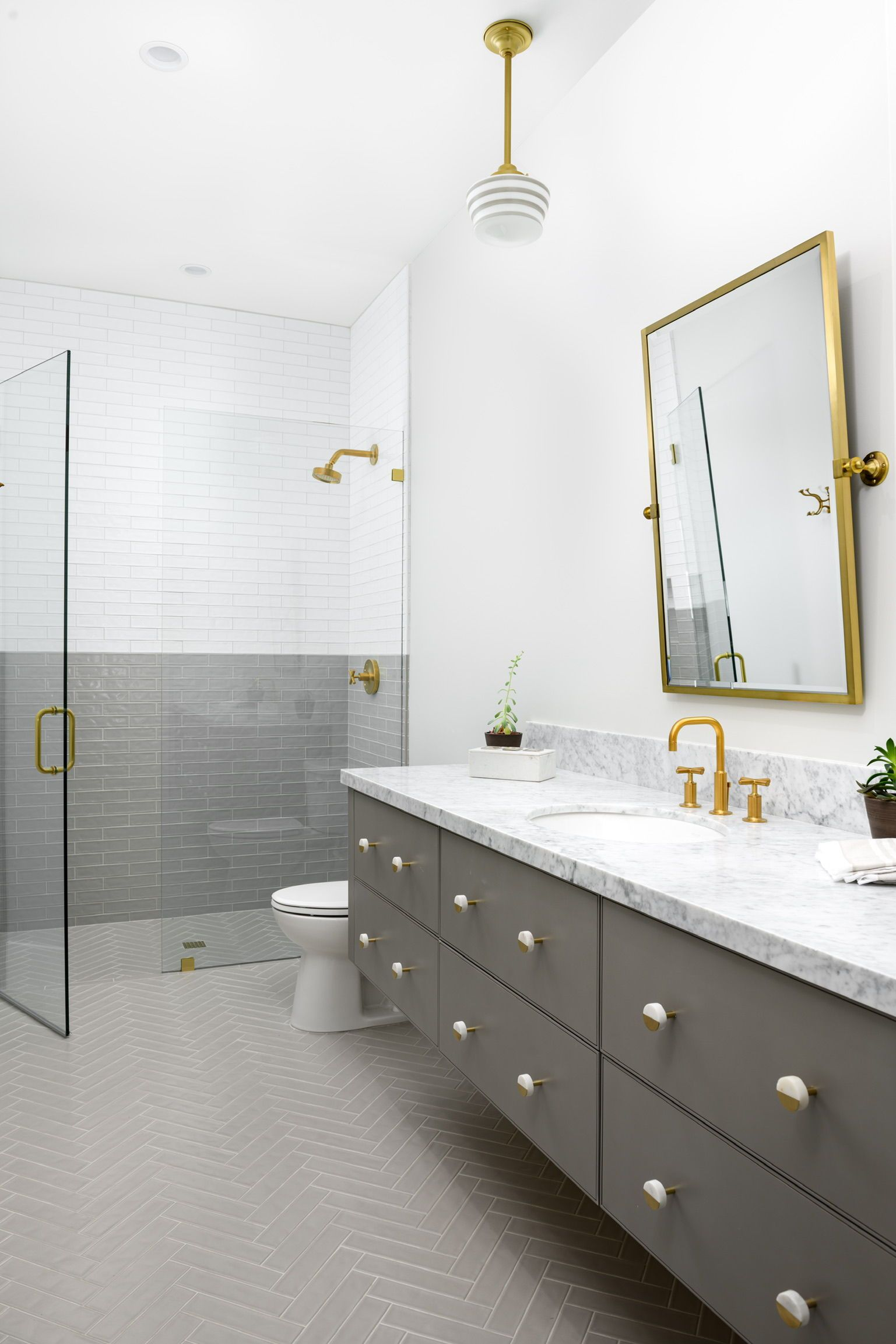 Grey And White Bathroom Ideas Modern Hard To Ignore This Stunning Bathroom With It S Marble Cou Gray And White Bathroom White Bathroom Herringbone Tile Floors