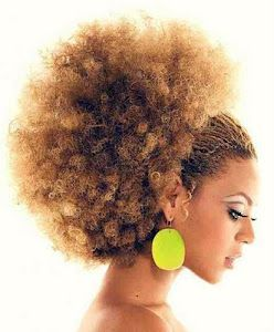 Afros are... a sun-kissed salute to the sky!