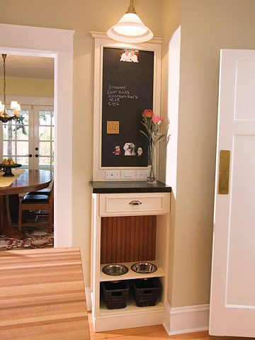 A corner message center! pet bowls down below and place to charge phone, etc...love this!
