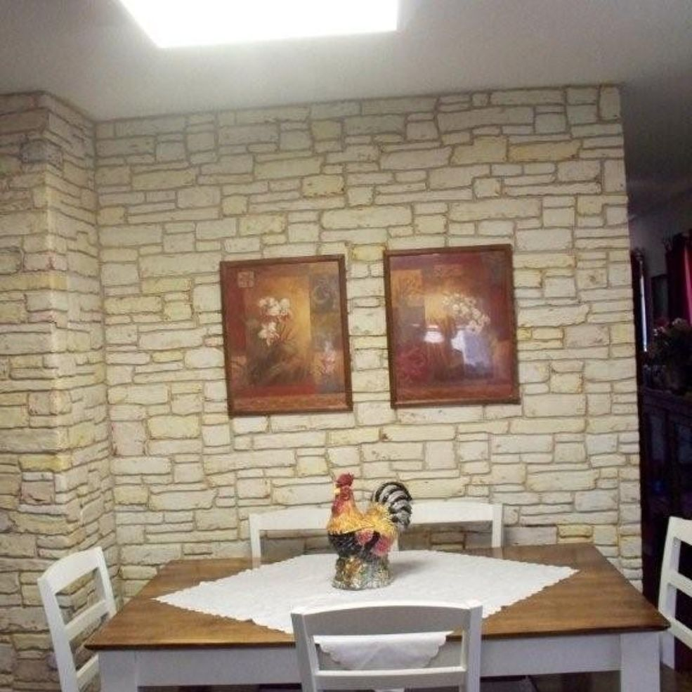 plain walls are transformed in to stone walls with joint compound rh pinterest com
