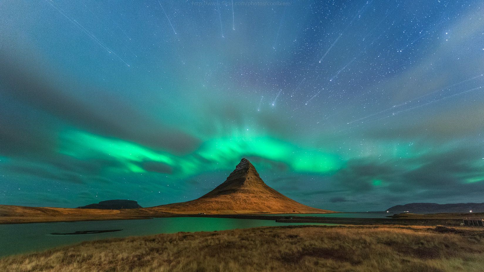 Starburst over Aurora Borealis in Iceland