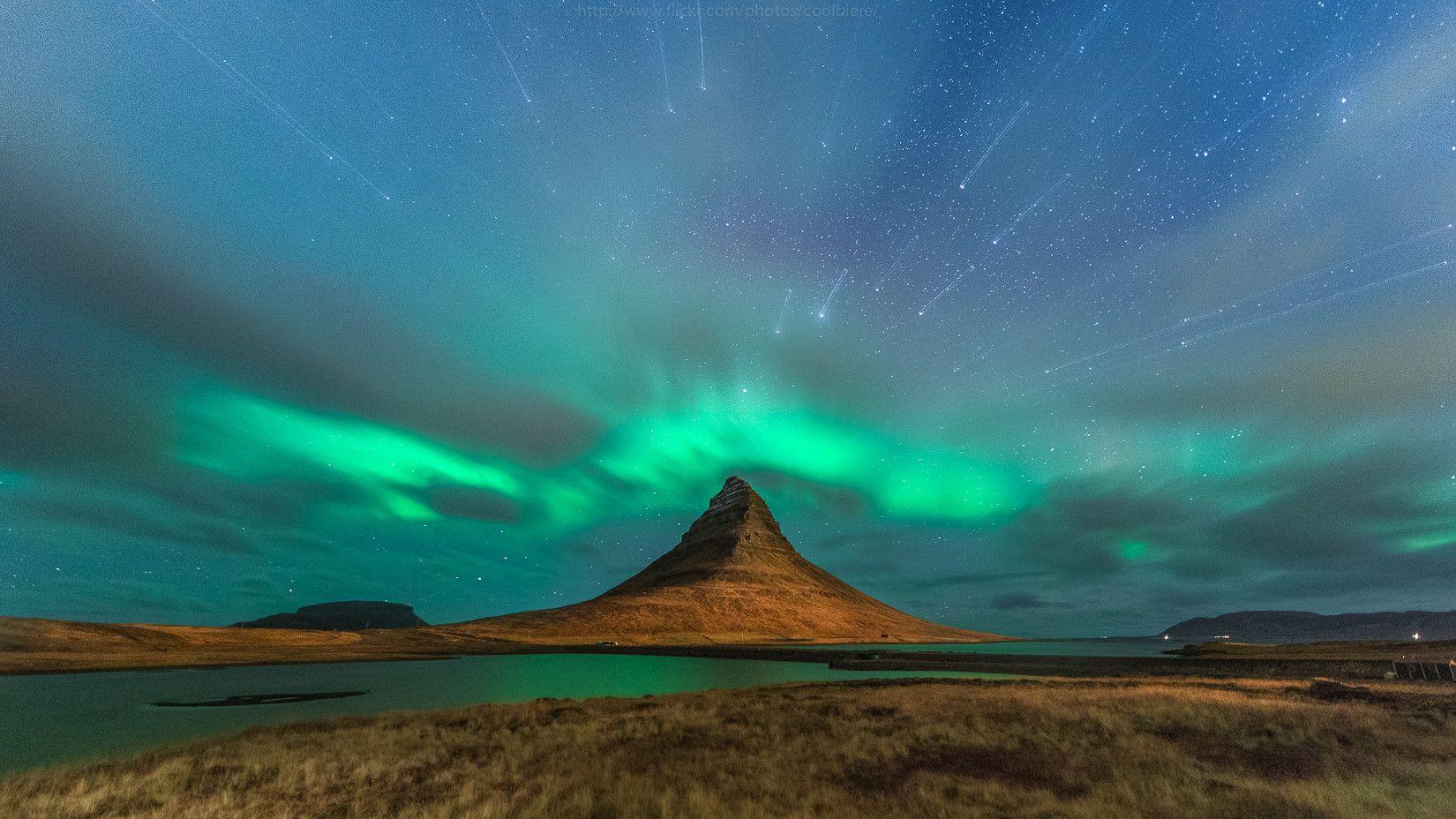 Starburst over Aurora Borealis in Iceland