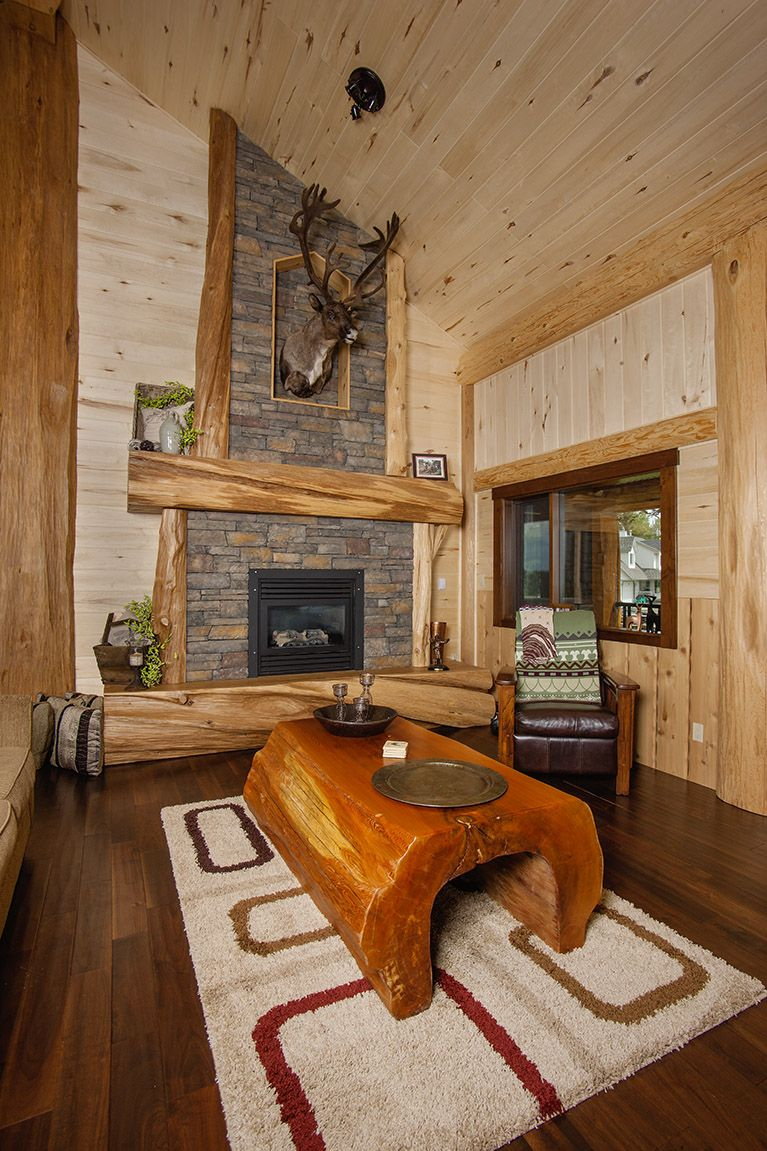 Log cabin loft bedroom  A beautiful shot of the living room and handcrafted log table from