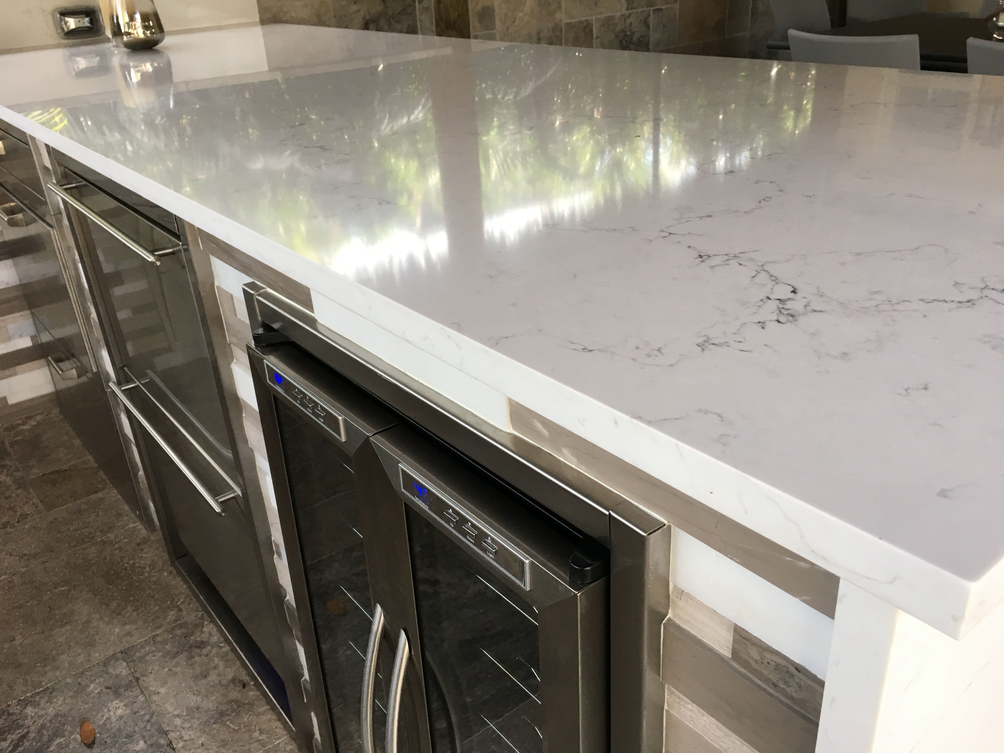 This is a beautiful outdoor kitchen. Calacatta quartz is a excellent accent to this outdoor kitchen. We fabricated and installed this quartz countertops and waterfall. This was in Boca Raton Fl.  Visit www.stoneandquartzsurfaces.  and then gallery - outdoor kitchens.