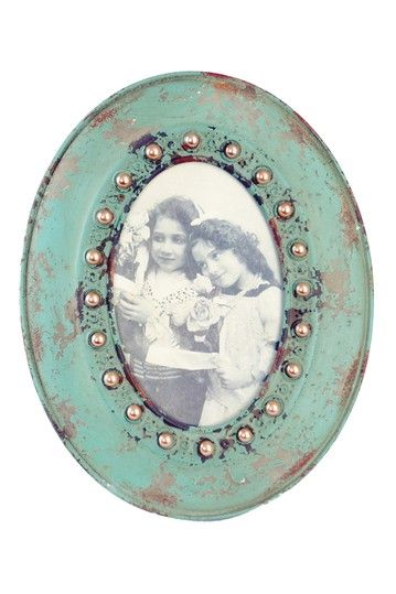 metal jeweled picture frame on by iron trade imports.