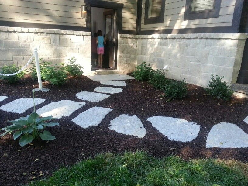 Limestone stepping stones with mulch in grass path for Stone stepping stones for garden paths