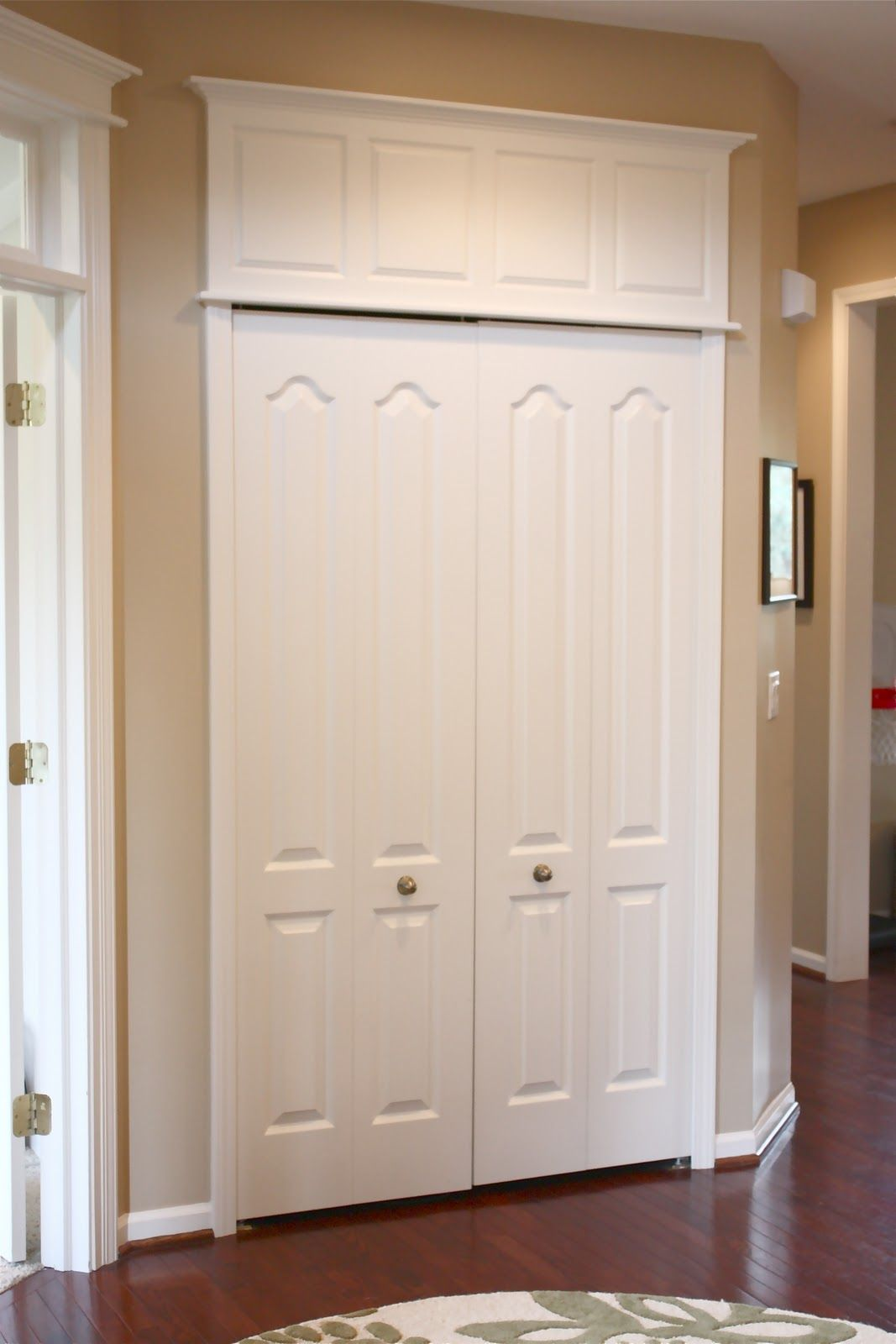 The Yellow Cape Cod: How To Make Doors Appear Taller · Door TrimsFoyer  IdeasCloset ...
