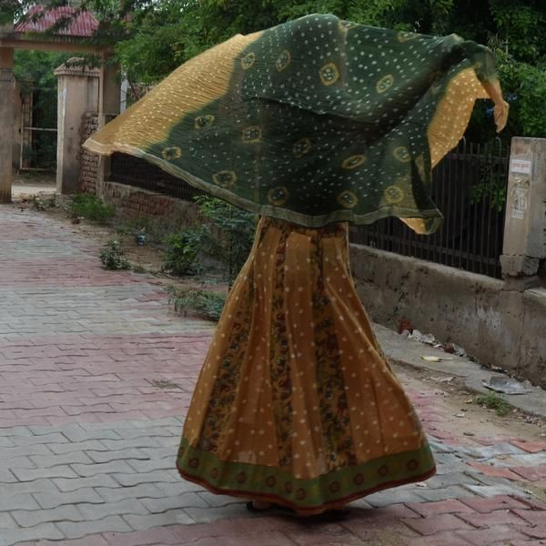 Gopi skirt lehenga made from 32 alternating panels of Jaipur tie dyed mustard yellow cotton and mustard yellow floral/horse cotton print from Vrindavan. Come...