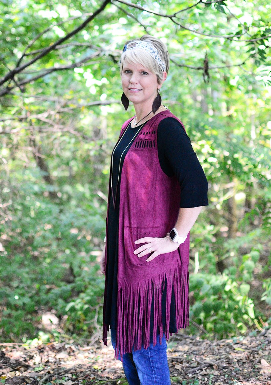 This long burgandy fringe vest is perfect for adding on top of your solid shirts! Pair with jeans and boots for a complete look. Shop now at Hip Chics Boutique!