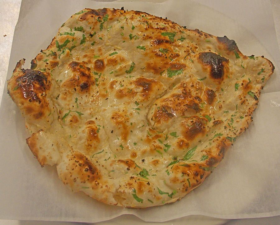 Freshly seasoned Naan, cooked, served & ready to eat! | New