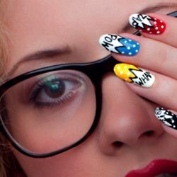 Be proud of your nerdy side with this colorful superhero nail art!