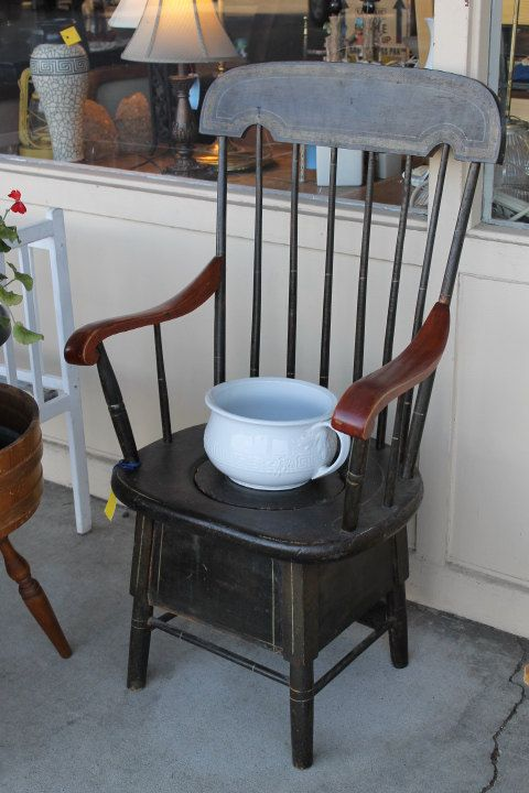 Antique potty chair with high, spindle back and shaped arm rests. Porcelain chamber  pot - Highback Antique Spindle-back Commode Chair With Porcelain Chamber