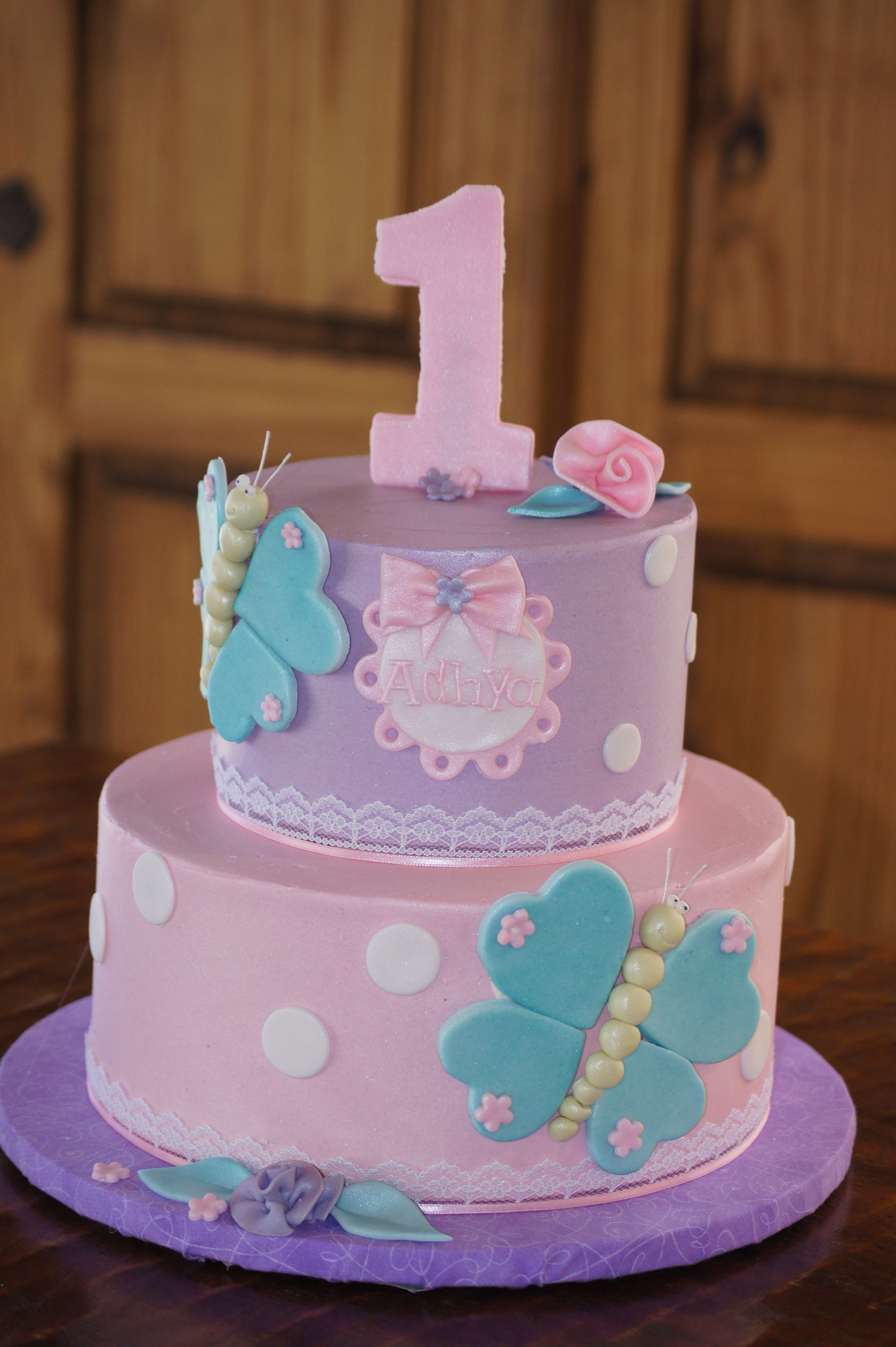 Tiered Pink And Purple Butterfly Cake With White Polka Dots