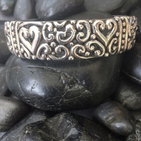 Vintage Sterling 925 heart scroll cuff bracelet Beautiful vintage 925 Sterling silver heart scroll bracelet.  This bracelet cuff is amazing.  Solid Sterling it features a heart design with beautiful scroll details.  A very nice piece. Vintage Jewelry Bracelets