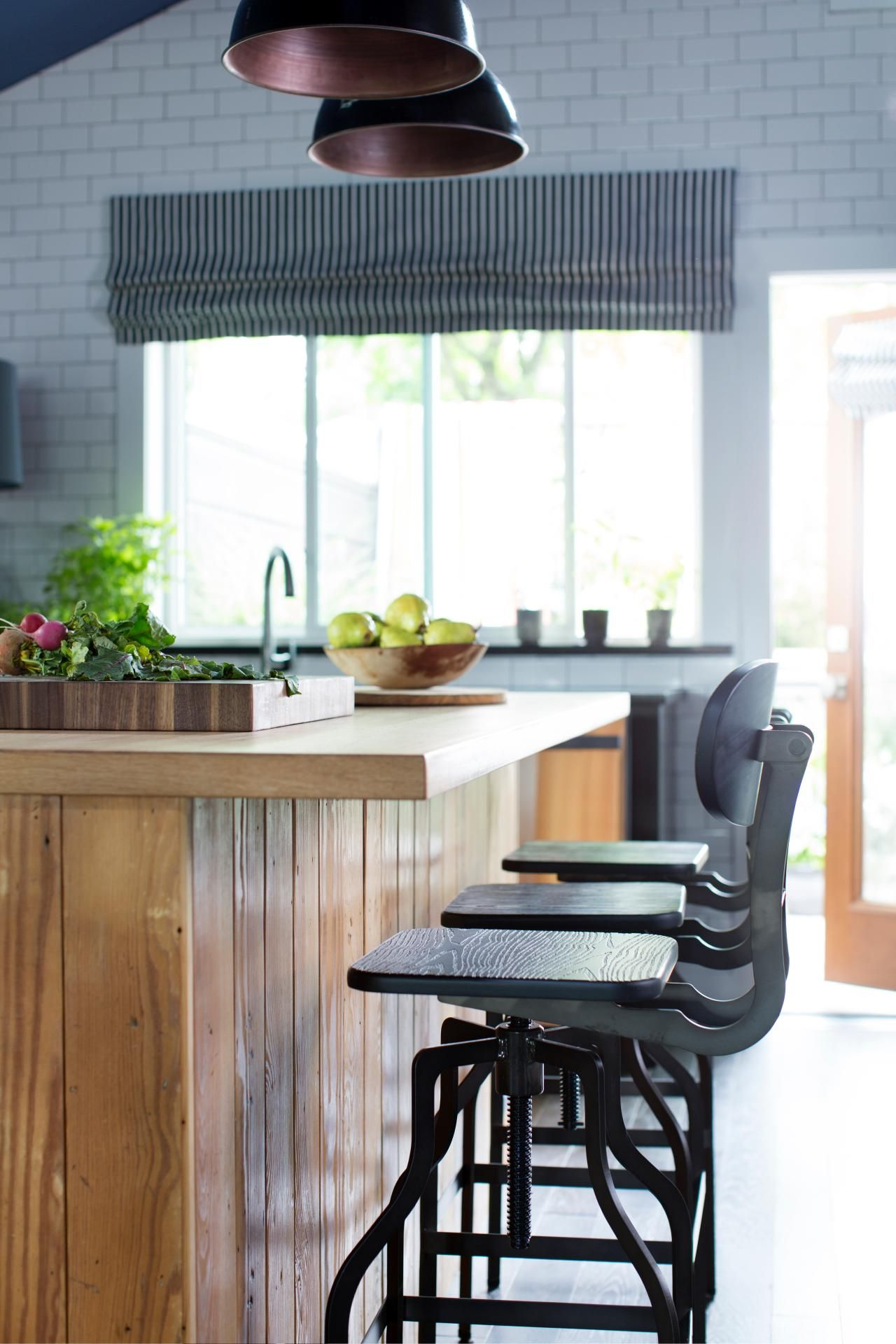 A custombuilt butcher block island is practical for meal