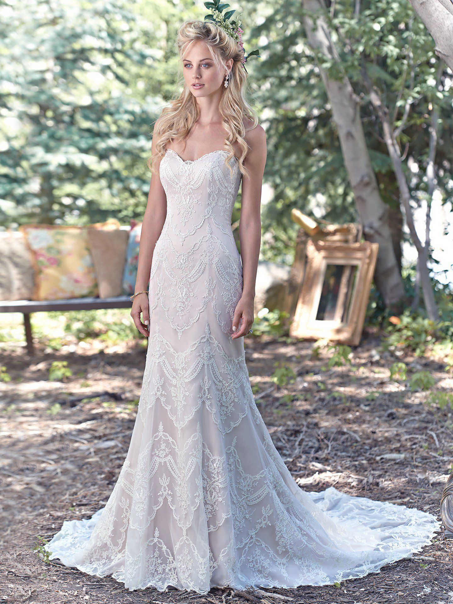 Elegant lace appliqués drift atop tulle to create this breathtaking bohemian  sheath wedding dress 15afd555b6e0
