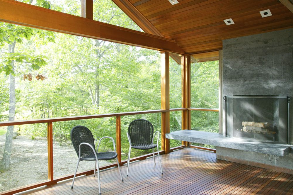 Love the wood, woods, and stone fireplace. Modern porch