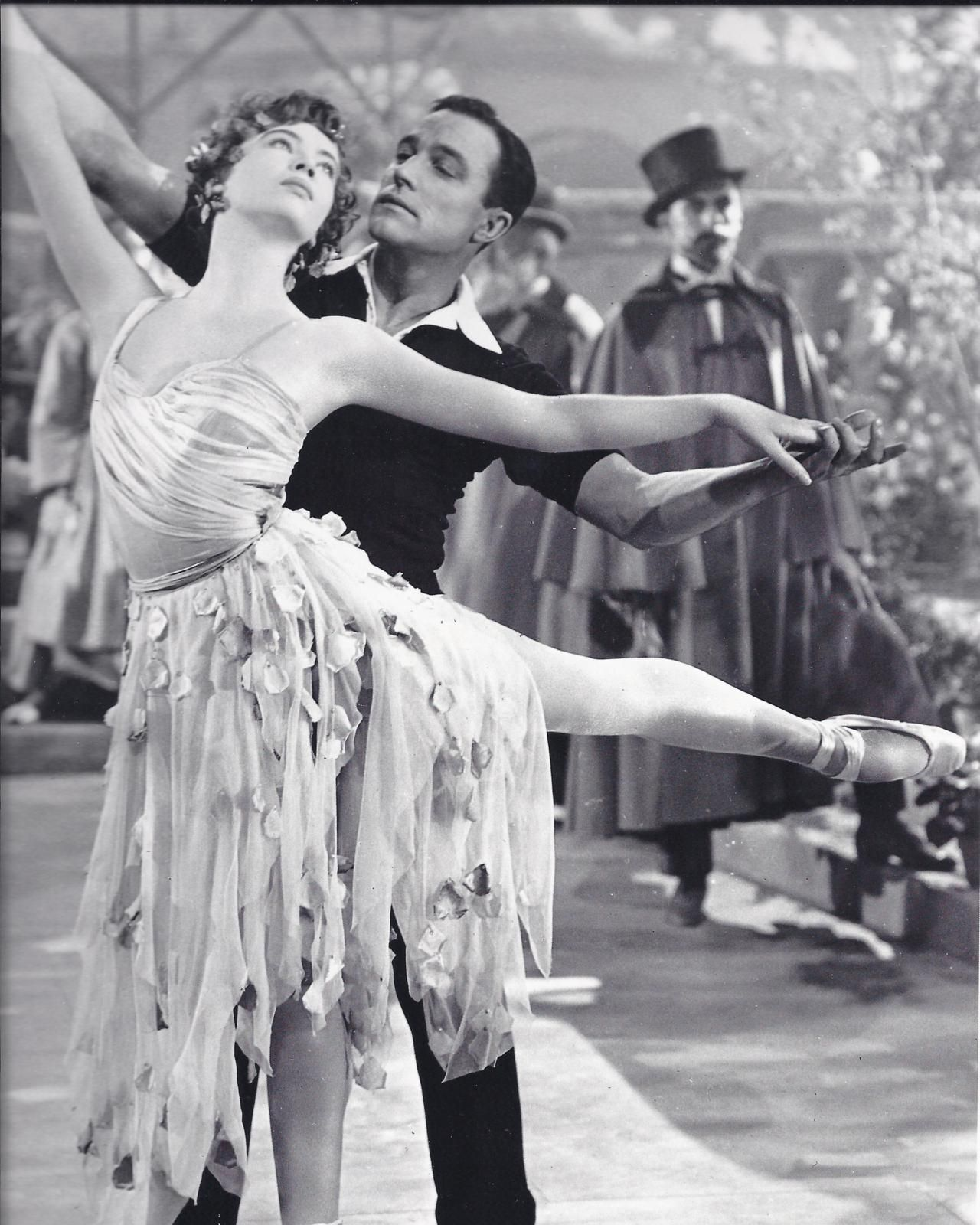 gene kelly + leslie caron = perfection  And her dress is beautiful. I bet it looks amazing when she's dancing.