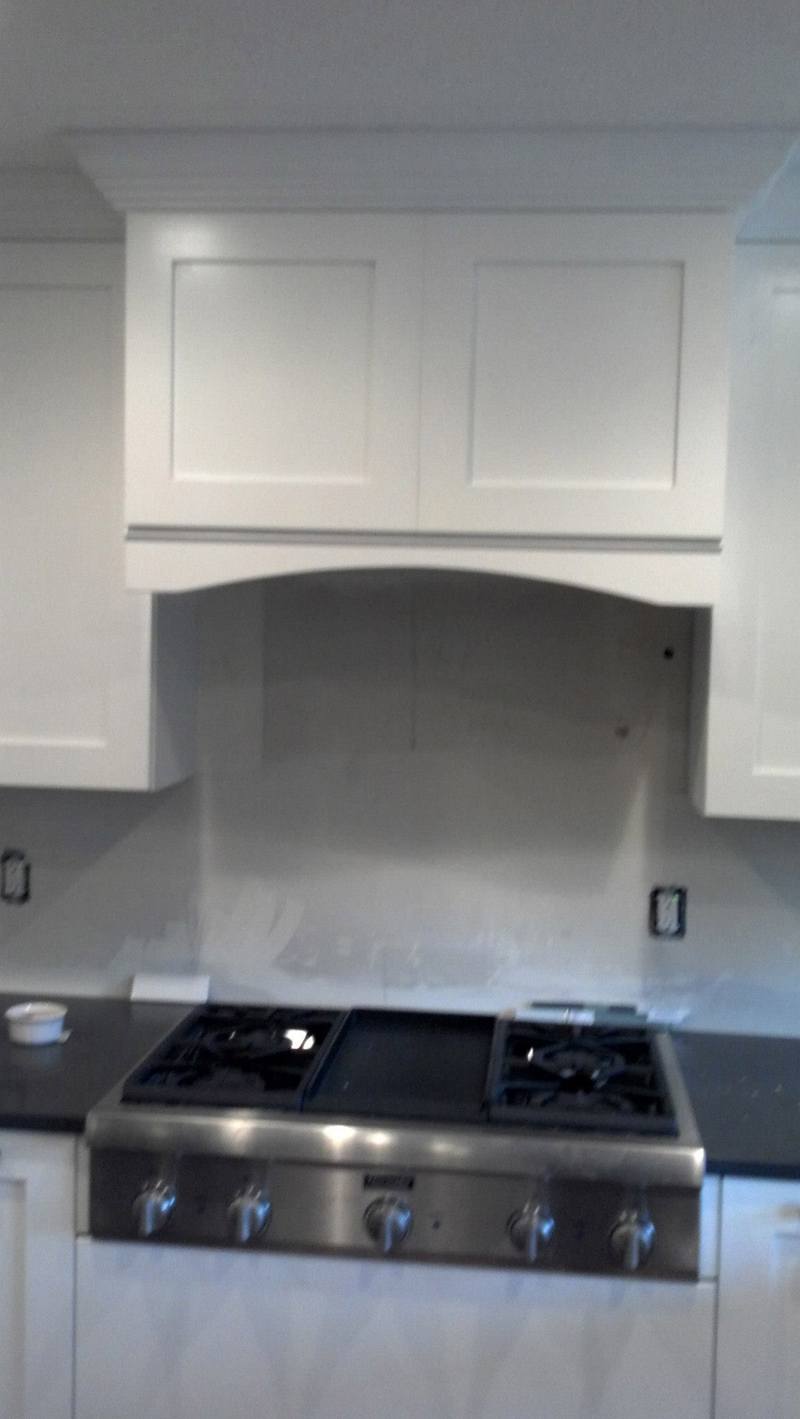Clean White Under Cabinet Proline Range Hood Install By Ivy League Builders.