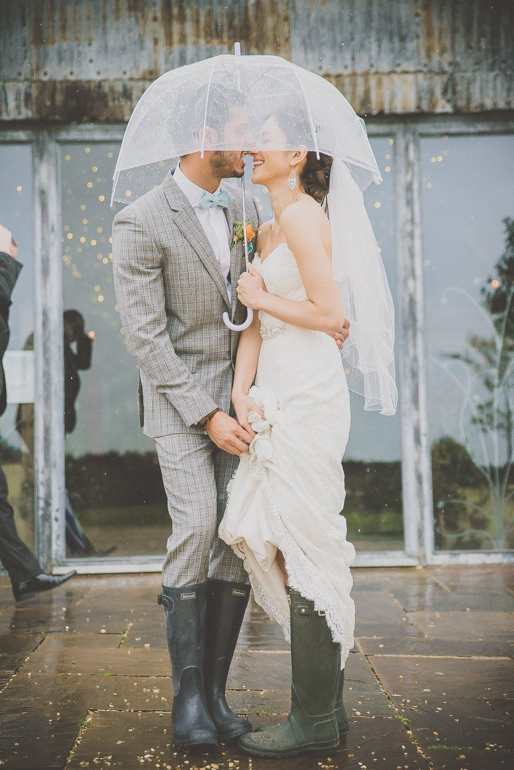 Rainy wedding photos coral shoes baby blue dresses and stone barns