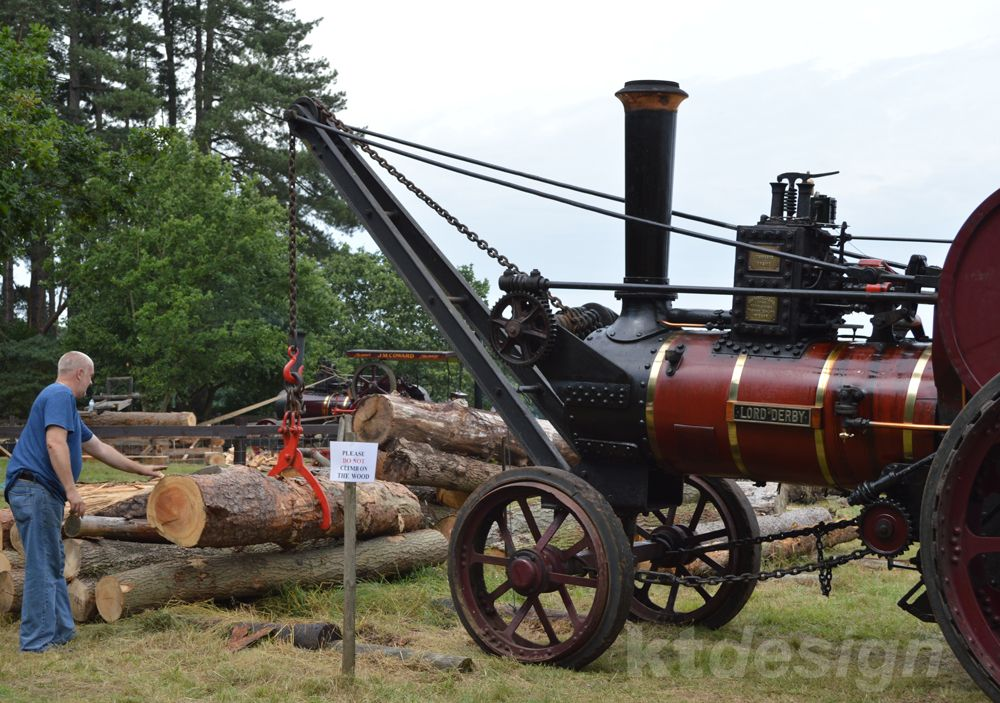 Here's the Burrell engine 'Lord Derby' lifting logs for sawing at the 2014 Weeting Steam Engine Rally & Country Show. This engine was built in 1915 and used for heavy haulage of sand and shale from Southport beaches. During 1939-45 it was used to pull down blitzed houses in Liverpool. It was acquired by Richard Parrott (Rally Chairman) in 1985. The crane and jib were originally fitted to the Burrell engine 'Emperor'.