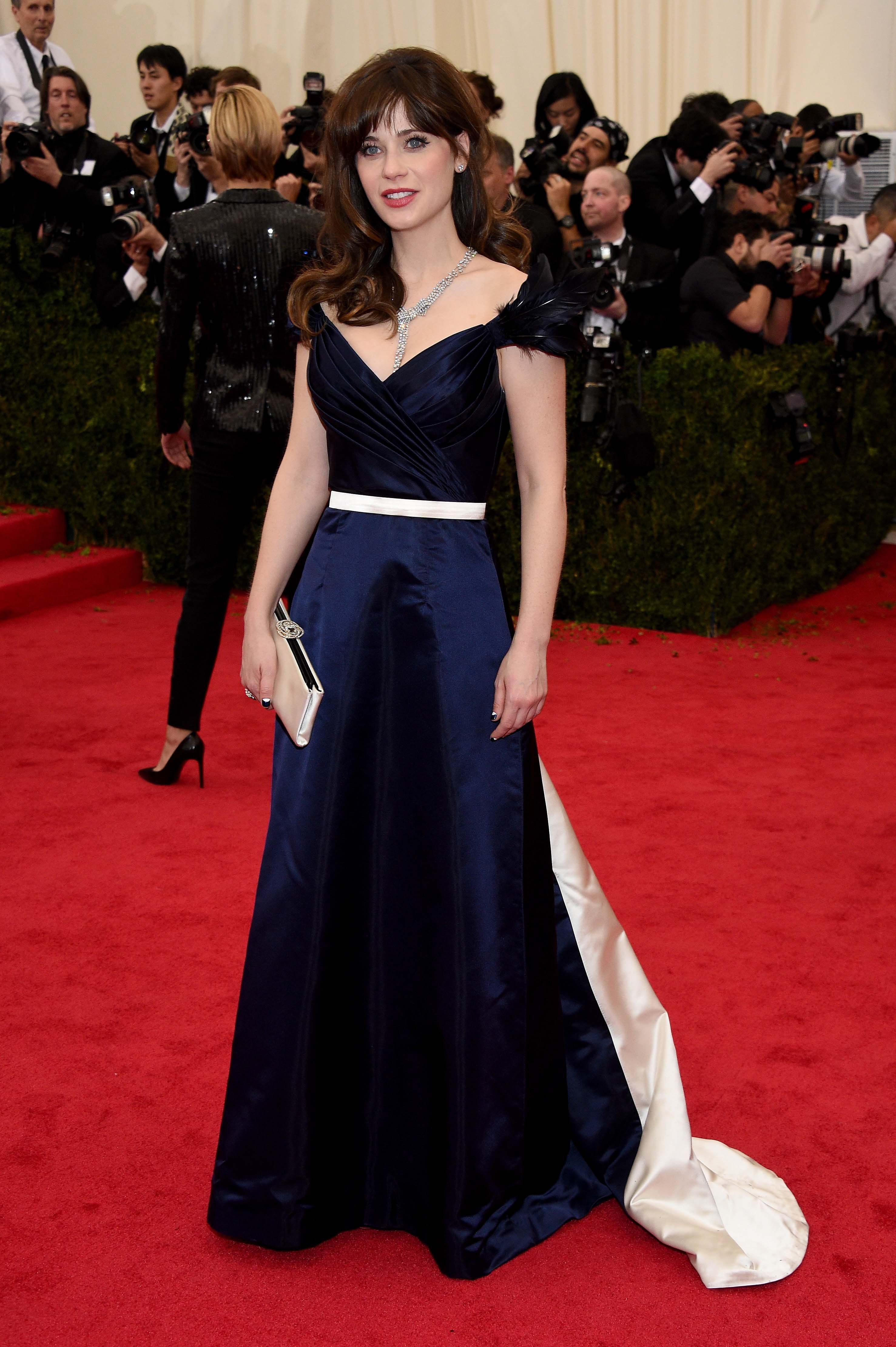 Zooey Deschanel wearing a midnight navy duchess satin gown by Tommy Hilfiger at the Met Gala 2014