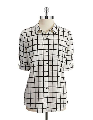 Get classic appeal with this blouse. Featuring a button closure, roll-tab sleeves and a windowpane design, pair this top with a pencil skirt and pumps for a chic, daytime look.