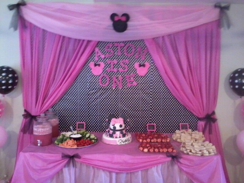 cake and food table for astons minnie mouse birthday party 1st birthday cake table