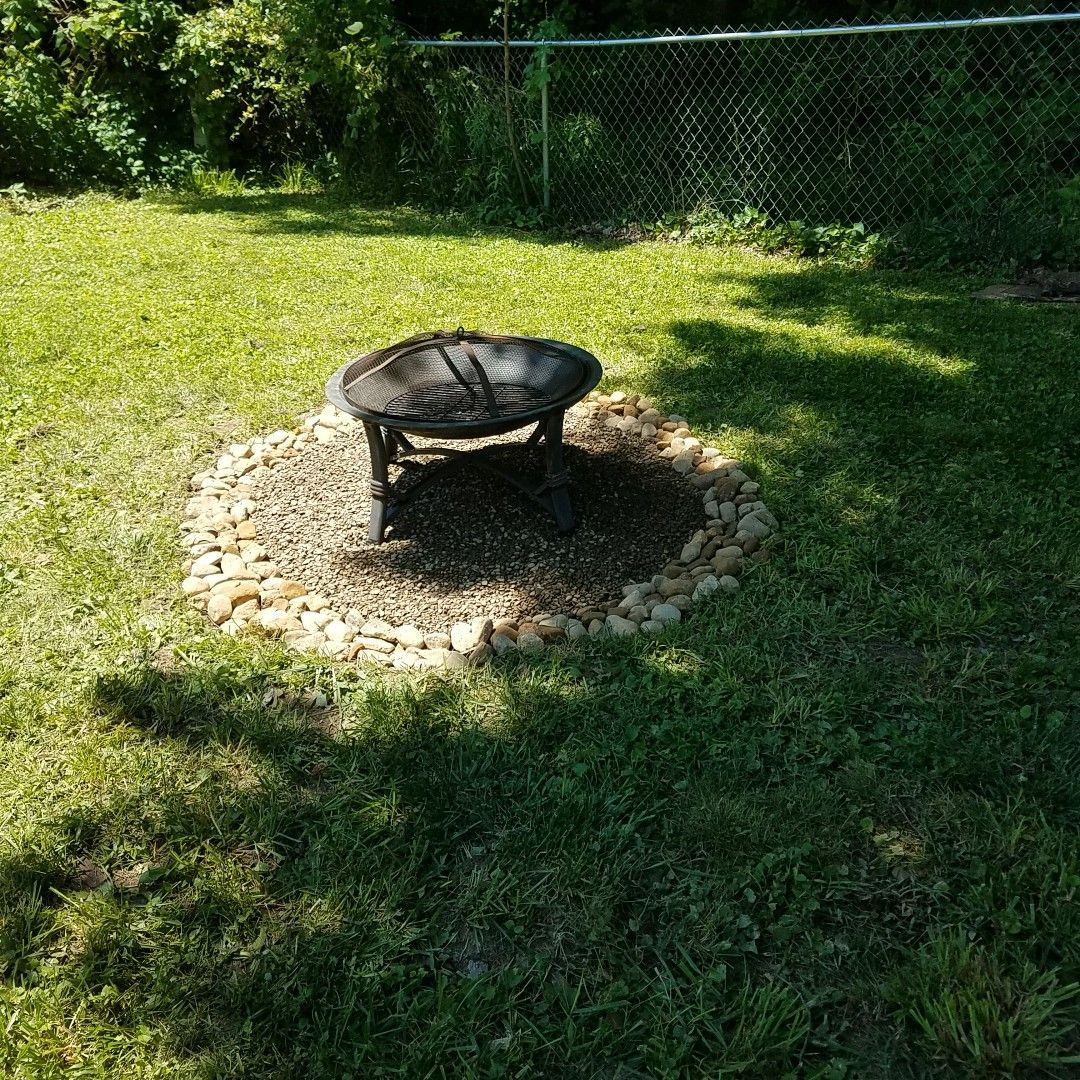 Backyard Firepit 1 Grass Dug Out And Leveled 2 Outlined With River Stone 3 Filled In With River Pebbles Fire Pit Backyard Fire Pit River Pebbles