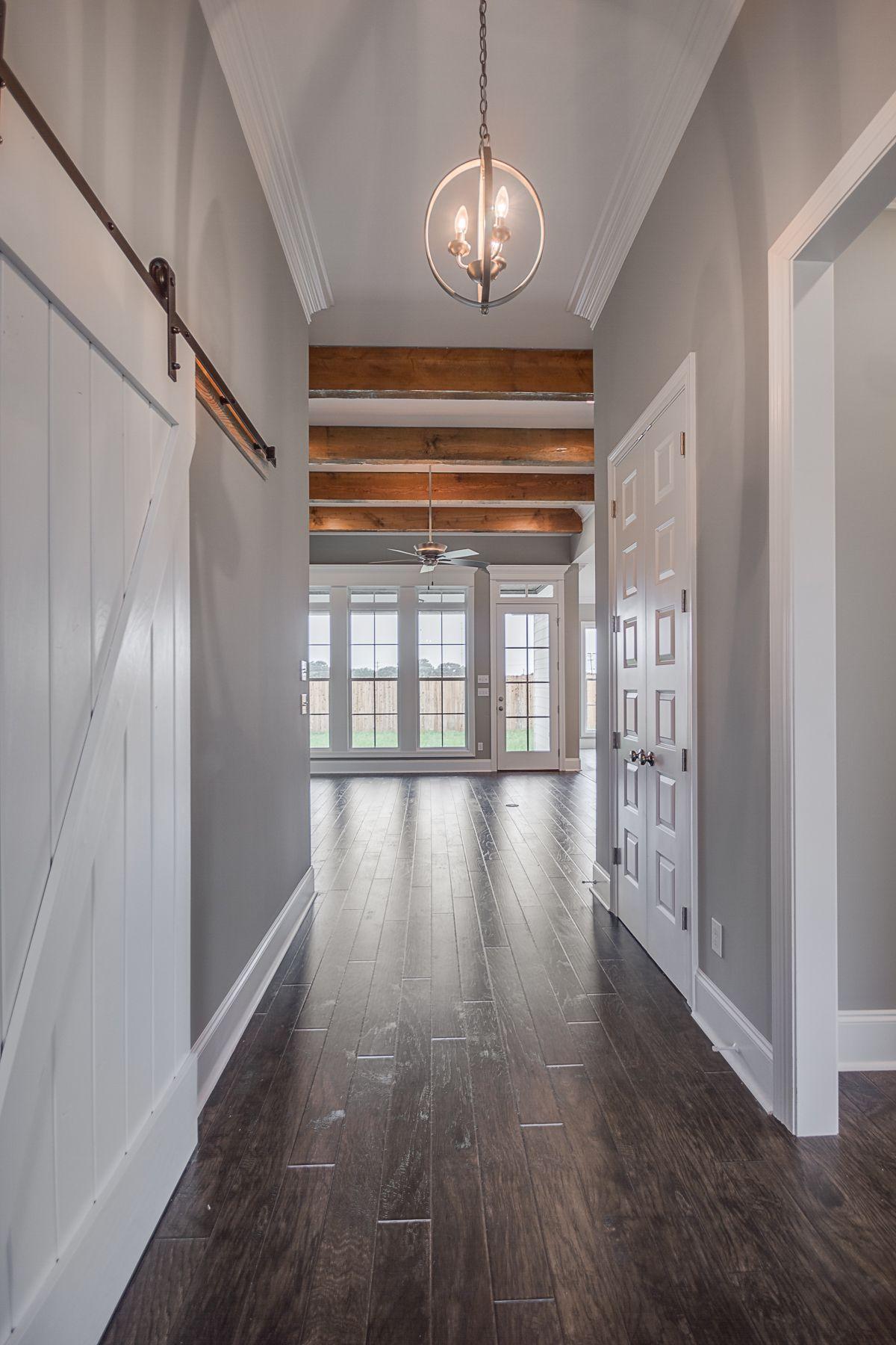 Wooden Beams - Development – Beau Savanne Plan: Orleans Elevation: Heritage II Living Square Feet: 1803 … | Doors Interior, Wood Doors Interior, Interior Barn Doors