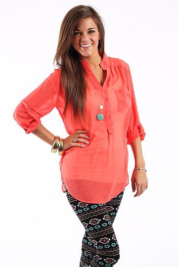 "Boyfriend Pocket Blouse, Coral $35.00 This sheer blouse is perfect to make your own! It features the option to button the sleeves up or let them down! Just put on the perfect layering tank or camisole with your favorite jewelry and jeans, then you're ready to go!   Fits true to size. Miranda is wearing a small.   From shoulder to hem:  Small- 28""  Medium- 28.5""  Large- 29"""