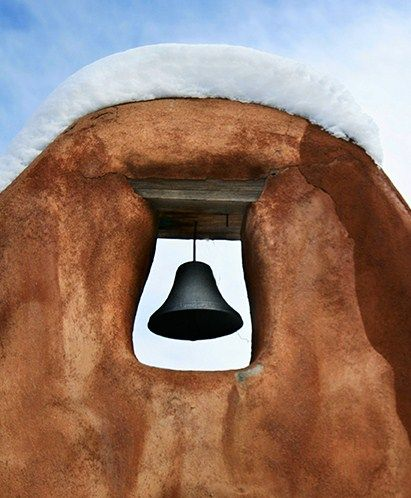 Adobe Church Bell Tower with Snow.