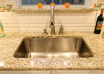 Single Bowl Stainless Steel Undermount Sink In A Kitchen   Giallo  Ornamental Granite
