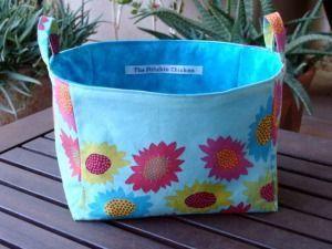 Fabric buckets tutorial. Very cute.