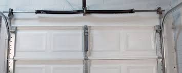 Install Tension Spring On An Overhead Garage Door Garage Door Springs Overhead Garage Door Garage Door Spring Replacement