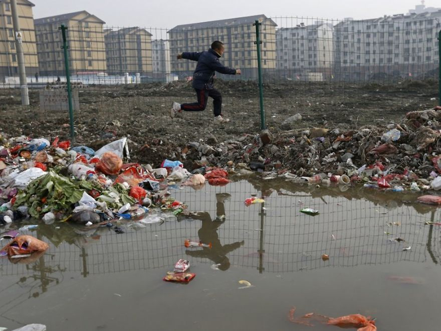 Image result for dumping thousands of tons of solid waste in areas close to the Yangtze River in Anhui province
