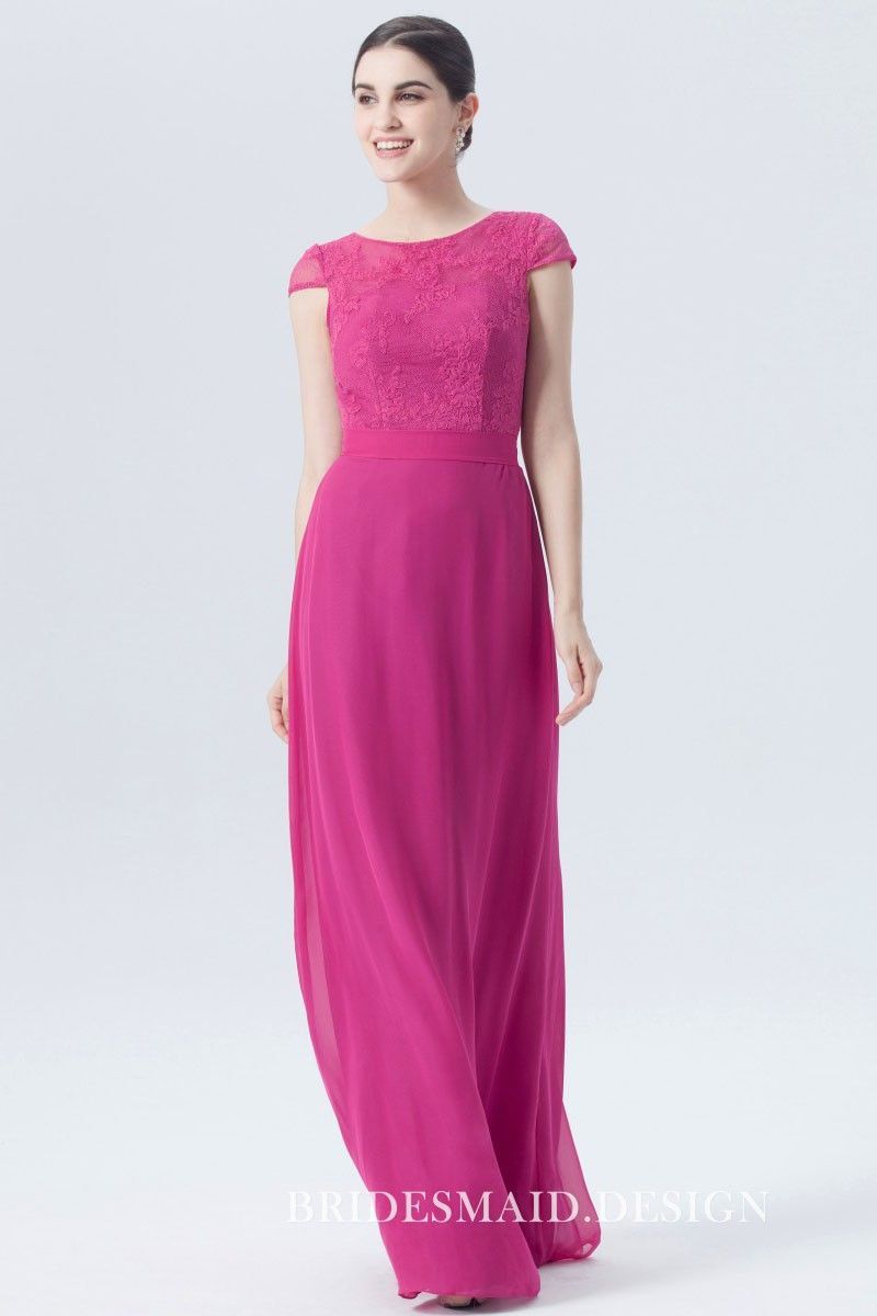 7813b4bb1b3 Bright fuchsia lace and chiffon bridesmaid dress in a demure style. It  comes in A-line silhouette and floor-skimming length