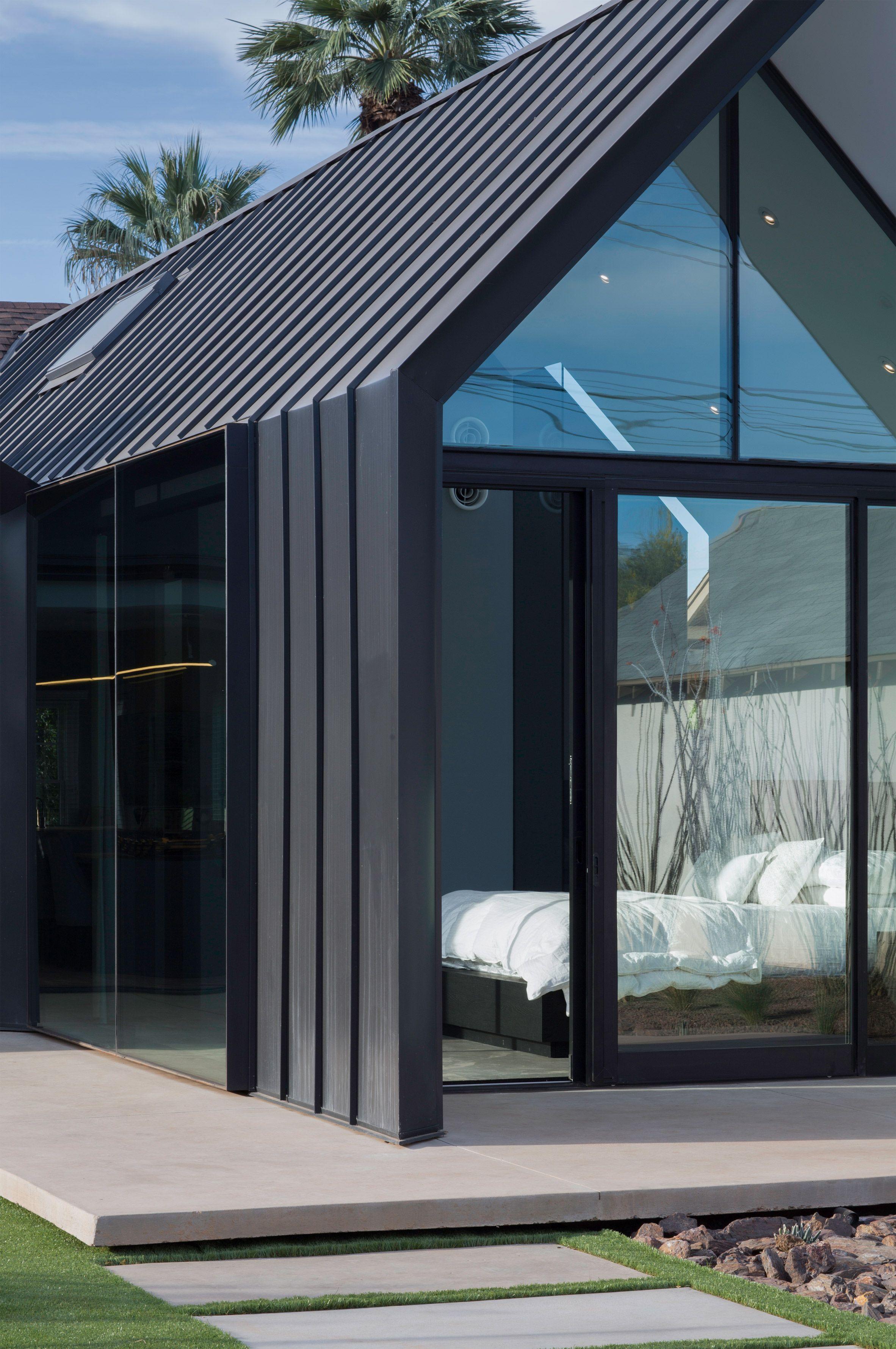Concrete patio outside a contemporary newly renovated home