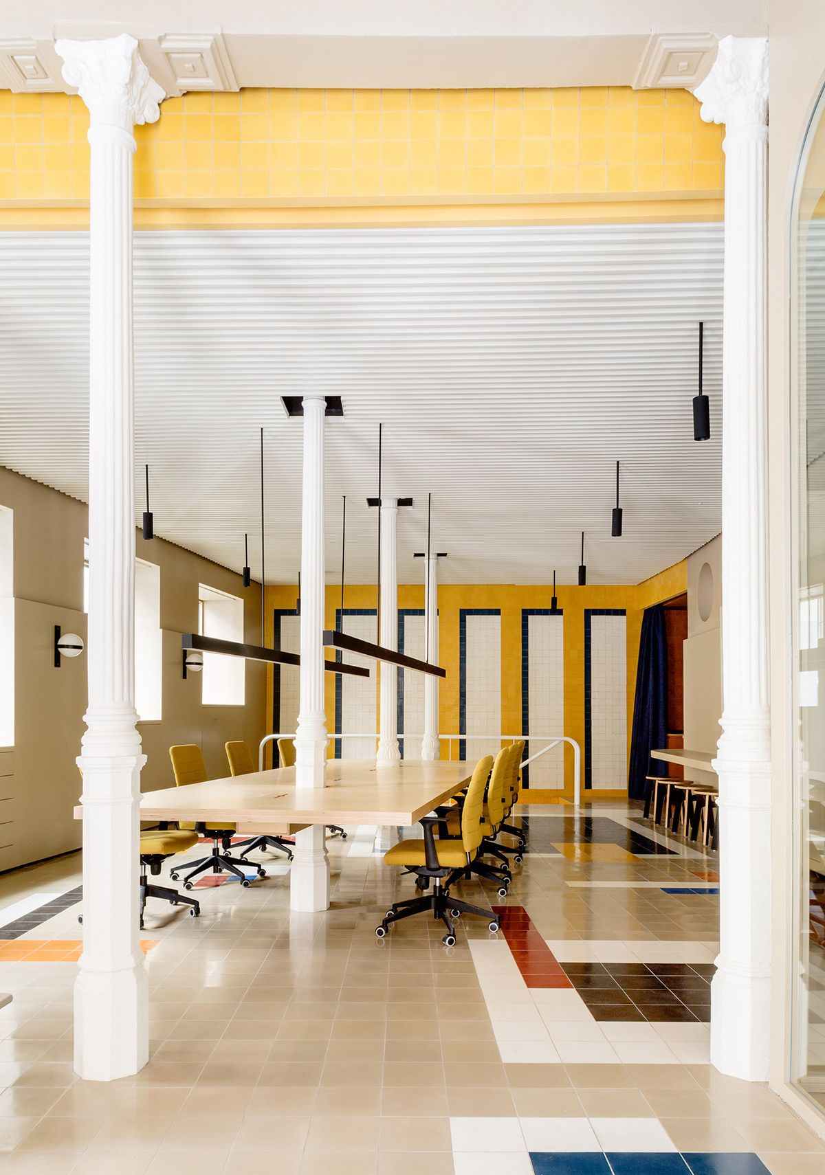 Mustard Curtains And Mondrian Inspired Tiles Are Totally Making This Madrid Ad Office Sight Unseen Interior Design School Boutique Interior Design Office Interiors