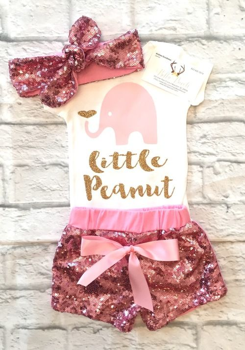 Baby Girl Clothes, Little Peanut Bodysuit, Little Peanut, Little Peanut Baby Pink and Gold, Little Peanut Onesies, Baby Girl Baby Shower Gift, Little Peanut is part of Baby Pink Clothes - Our sparkle and non sparkle clothing is a huge hit  Sure to be the best baby shower or birthday present you can give! Will make each child or receipient the complete center of attention! LISTINGS THAT SHOW ACCESSORIES SUCH AS BOWS, HEADBANDS, TUTU'S, BLOOMERS, BOWS, AND OR LEG WARMERS ARE NOT INCLUDED, THESE ITEMS CAN BE PURCHASED IN THE ACCESSORIES SECTION OF OURWEBSITE! LS IS LONG SLEEVE SS IS SHORT SLEEVE  FOR WHITE BODYSUITS OTHER THAN OUR TWIN SETS, CARTERS BRANDS ARE USED  CARTERS SIZING IS AS FOLLOWS, NEWBORN Height up to 21 5 inches, weight 58 pounds 3 MONTHS (equivalent to 03 months) Height 21 524 inches, weight 812 5 6 MONTHS (equivilant to 36 months) Height 2426 5 inches, weight 12 516 5 9 MONTHS (equivilant to 69 months) Height 26 528 5 inches, weight 16 520 5 12 MONTHS Height 28 530 5 inches, weight 20 524 5 18 MONTHS Height 30 532 5 inches, weight 24 527 5 24 MONTHS Height 32 543 inches, weight 2730  IF AN ITEM REQUIRES A NAME TO BE LEFT, IT MUST BE LEFT IN THE MESSAGE TO SELLER AT CHECKOUT, IF IT IS NOT LEFT THE LISTED SHIRT WITH THE NAME WILL BE SENT  IF YOU ARE PURCHASING A MONORAM ITEM THE FOLLOWING MUST BE LEFT AT CHECKOUT, IF IT IS NOT LEFT THE LISTED SHIRT WILL BE MAILED  LETTER LETTER COLOR NAME NAME COLOR BOW COLOR At checkout be sure to leave the font glitter color you want  IF THIS INFORMATION IS NOT LEFT THE COLOR SHOWN WILL BE USED  EACH SHIRT SIZE HAS TO BE SELECTED AT CHECKOUT  BOTH SIZES NEED TO BE SELECTED AT CHECKOUT! HAIRBOWS WILL BE ALLIGATOR CLIPS UNLESS OTHERWISE STATED  WASHING INSTRUCTIONS Be sure to wash inside out  That is to protect the glitter from being damaged  WE suggest washing and drying inside out to prevent cracking as well  We use high quality materials to make sure that you get a lasting Shirt, however just as you get with any shir