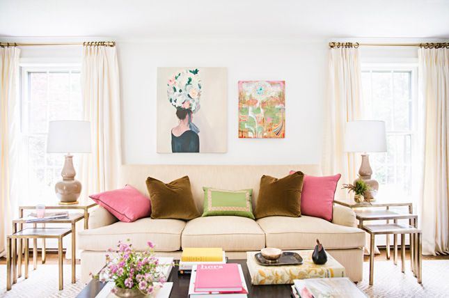 Lovely work by McGrath II-- cream sofa and curtains, gold curtain rods and tiered end tables, colorful throw pillows.