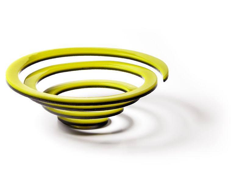 Yellow spiral fused glass bowl by Kim Brill.