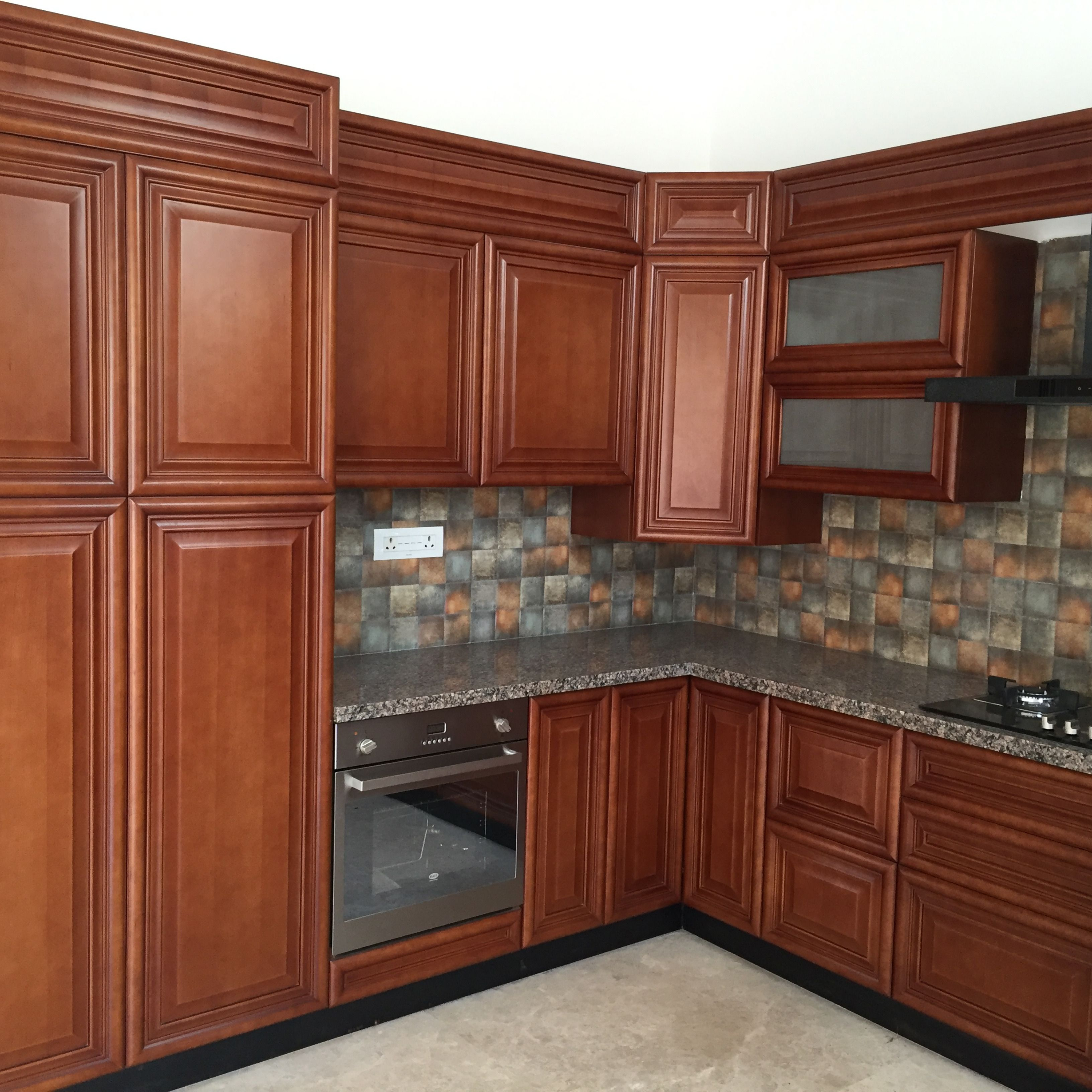 Modular kitchen with Island counter in Wood finish ...