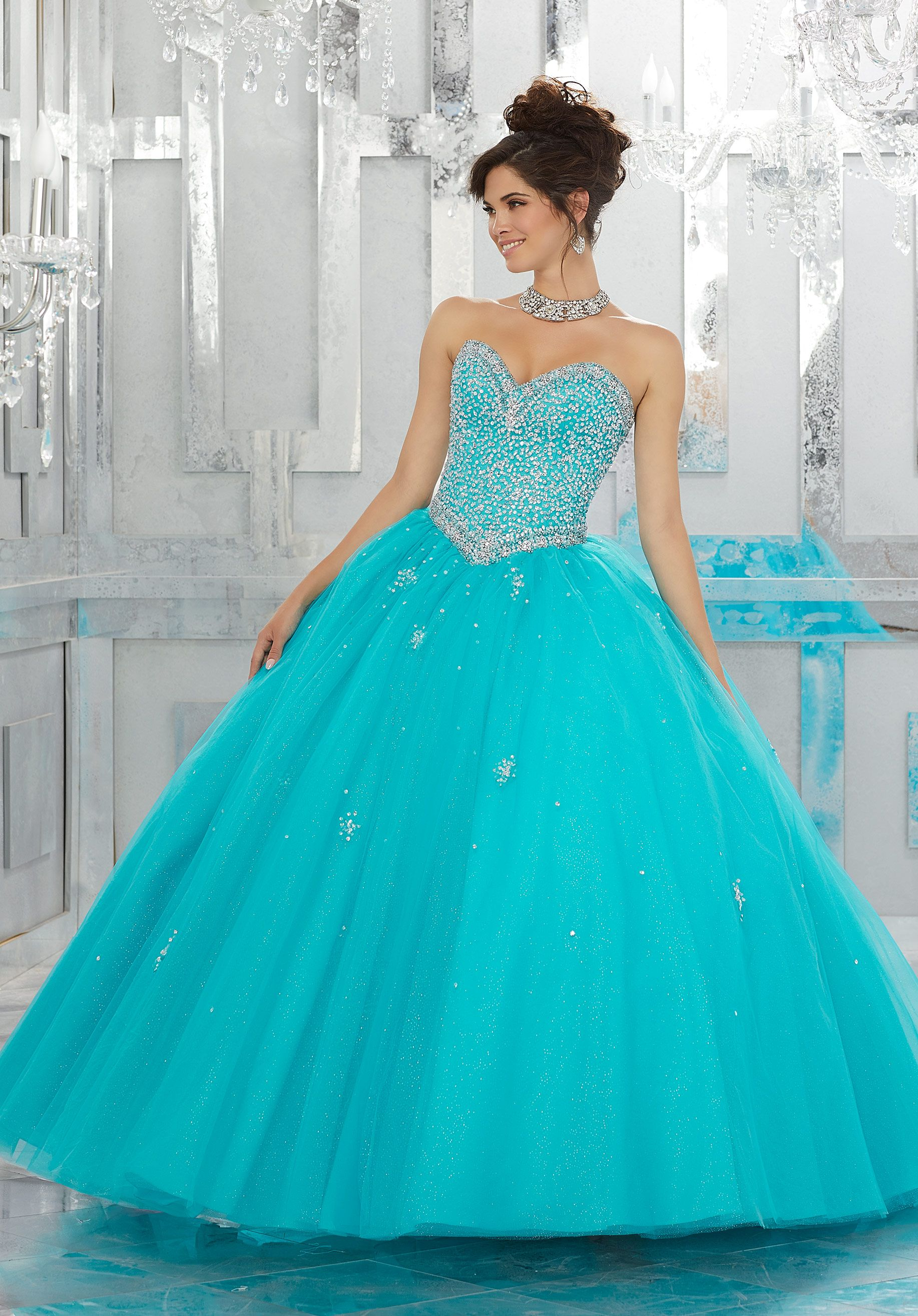Aqua and fit for a fairytale this tulle quinceañera ball gown