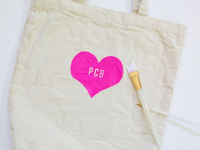 pink-heart-monogrammed-tote-bag We can do mickey ears instead of the heart...