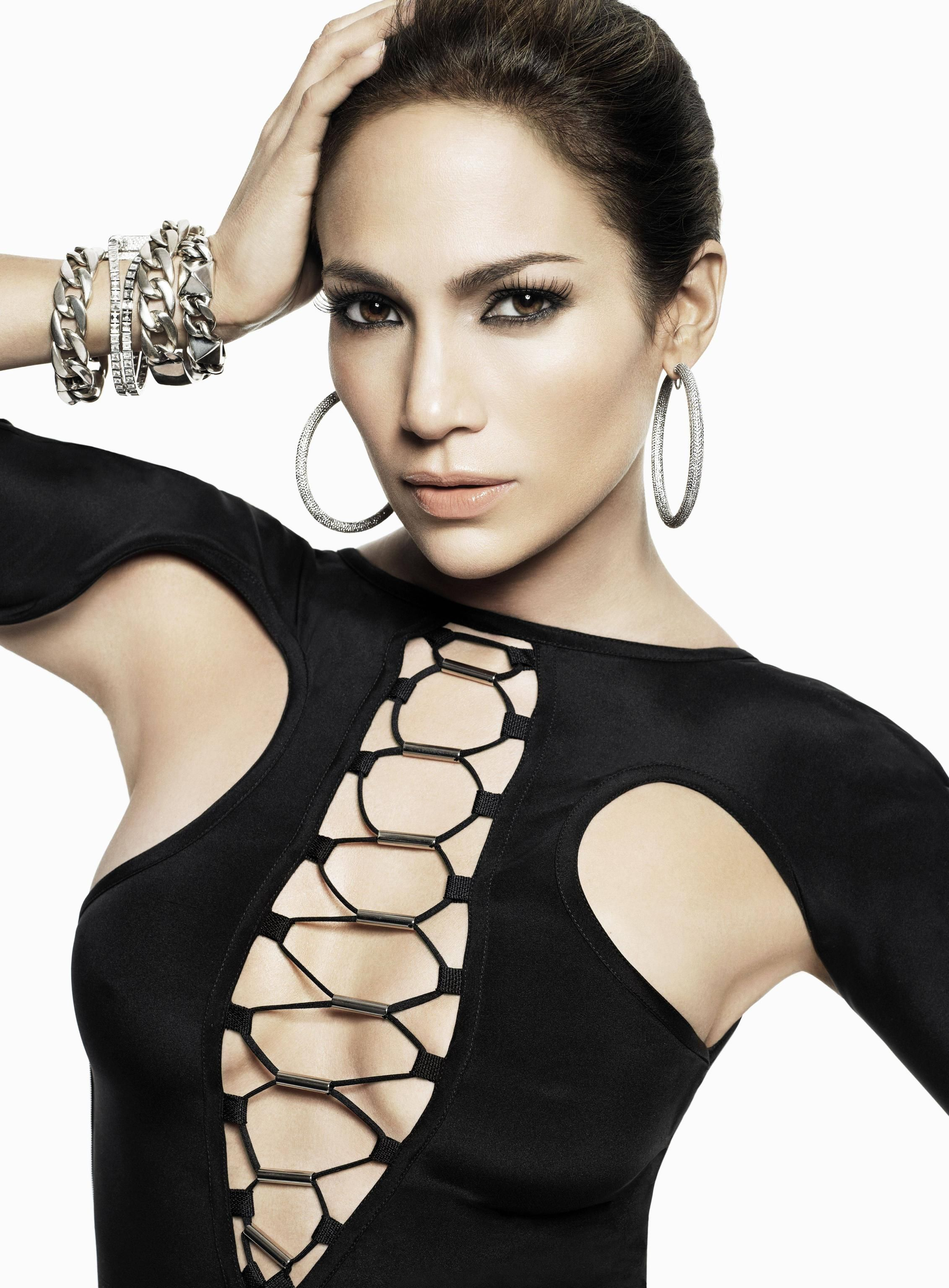 301f678c1505 Jennifer Lopez sexy fashion shot tied up front cut out black top big silver  bangles and hoop earrings